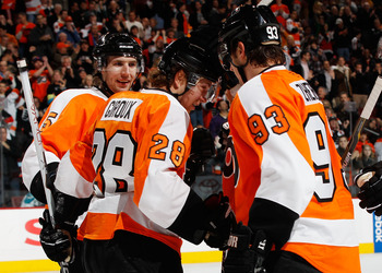 PHILADELPHIA - DECEMBER 08:  Claude Giroux #28 of the Philadelphia Flyers  celebrates his second period goal with teammates Nikolay Zherdev #93 and Braydon Coburn #5 against the San Jose Sharks on December 8, 2010 at the Wells Fargo Center in Philadelphia