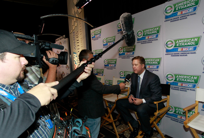 LAS VEGAS, NV - DECEMBER 02:  NASCAR Chairman and CEO Brian France (R) speaks to the media after announcing that American Ethanol led by Growth Energy will becomes an Official Partner of NASCAR after the NASCAR Sprint Cup Series Champions Week NMPA Myers