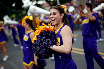 BATON ROUGE, LA - SEPTEMBER 19:  Members of the Louisiana State University Tigers Cheerleaders cheer for the crowd before playing the University of Louisiana-Lafatette Ragin' Cajuns at Tiger Stadium on September 19, 2009 in Baton Rouge, Louisiana.  (Photo