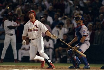 8 Sep 1998: Mark McGwire #25 of the St. Louis Cardinals hits his 62nd home run during the game against the Chicago Cubs at the Busch Stadium in St. Louis, Missouri. The Cardinals defeated the Cubs 6-3.