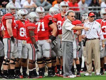 COLUMBUS, OH - SEPTEMBER 25:  Head Coach Jim Tressel of the Ohio State Buckeyes directs his team during a game against the Eastern Michigan Eagles at Ohio Stadium on September 25, 2010 in Columbus, Ohio.  Ohio State won 73-20. (Photo by Jamie Sabau/Getty