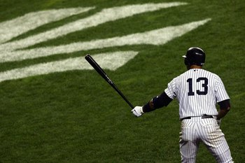 NEW YORK - OCTOBER 08:  Alex Rodriguez #13 of the New York Yankees stands on deck against the Cleveland Indians during Game Four of the American League Division Series at Yankee Stadium on October 8, 2007 in the Bronx borough of New York City.  (Photo by