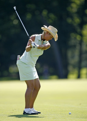SYLVANIA, OH - JULY 10: Michelle McGann hits her second shot on the 12th hole during the first round of the Jamie Farr Owens Corning Classic at Highland Meadows Golf Club on July 10, 2008 in Sylvania, Ohio. (Photo by Hunter Martin/Getty Images)