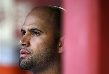 PHOENIX - JUNE 11:  Albert Pujols #5 of the St. Louis Cardinals in the dugout during the Major League Baseball game against the Arizona Diamondbacks at Chase Field on June 11, 2010 in Phoenix, Arizona. The Cardinals defeated the Diamondbacks 5-2.  (Photo