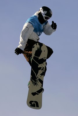 ASPEN, CO - JANUARY 28:  Shaun White of Carlsbad, California takes his first run enroute to winning the gold medal in the Men's Snowboard Slopestyle at Winter X Games 10 on January 28, 2006 at Buttermilk Mountain in Aspen, Colorado.  (Photo by Doug Pensin