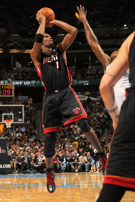 DENVER, CO - JANUARY 13:  Chris Bosh #1 of the Miami Heat takes a shot against the Denver Nuggets at the Pepsi Center on January 13, 2011 in Denver, Colorado. NOTE TO USER: User expressly acknowledges and agrees that, by downloading and or using this phot