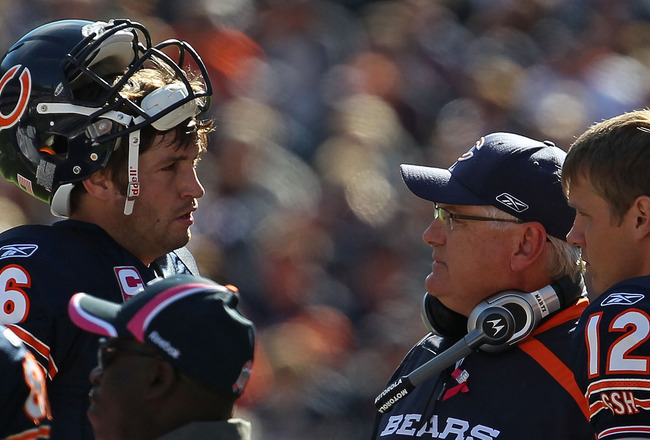 CHICAGO - OCTOBER 17: Jay Cutler #6 of the Chicago Bears talks with offensive coordinator Mike Martz during a time-out as Caleb Hanie #12 listens in against the Seattle Seahawks at Soldier Field on October 17, 2010 in Chicago, Illinois. The Seahawks defea