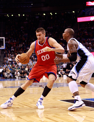 ORLANDO, FL - DECEMBER 18:  Spencer Hawes #00 of the Philadelphia 76ers is guarded by Quentin Richardson #5 of the Orlando Magic during the game at Amway Arena on December 18, 2010 in Orlando, Florida.  NOTE TO USER: User expressly acknowledges and agrees