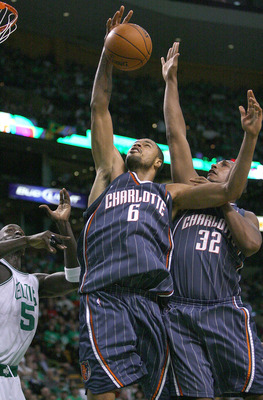 BOSTON, MA - OCTOBER 28:  Tyson Chandler #6 of the Charlotte Bobcats grabs a rebound with the help of teammate Boris Diaw #32 against the Boston Celtics at the TD Banknorth Garden on October 28, 2009 in Boston, Massachusetts. NOTE TO USER: User expressly