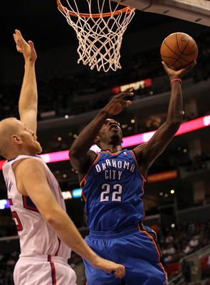 LOS ANGELES - NOVEMBER 3:  Jeff Green #22 of the Oklahoma City Thunder shoots over Chris Kaman #35 of the Los Angeles Clippers at Staples Center on November 3, 2010 in Los Angeles, California.  NOTE TO USER: User expressly acknowledges and agrees that, by