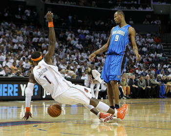 CHARLOTTE - APRIL 24:  Guard Stephen Jackson #1 of the Charlotte Bobcats draws an offensive foul on forward Rashard Lewis #9 of the Orlando Magic during Game Three of the Eastern Conference Quarterfinals during the 2010 NBA Playoffs at Time Warner Cable A