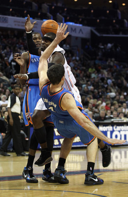 CHARLOTTE, NC - DECEMBER 21:  Teammates Kevin Durant #35 and Nick Collison #4 of the Oklahoma Thunder try to stop Stephen Jackson #1 of the Charlotte Bobcats during their game at Time Warner Cable Arena on December 21, 2010 in Charlotte, North Carolina. N