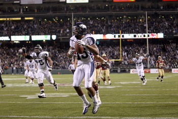SAN FRANCISCO, CA - JANUARY 09:  Richard Matthews #15 of the Nevada Wolf Pack runs a reception in for a touchdown in their game against Boston College during the Kraft Fight Hunger Bowl at AT&T Park on January 9, 2011 in San Francisco, California.  (Photo