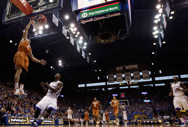 LAWRENCE, KS - JANUARY 22:  Dogus Balbay #4 of the Texas Longhorns scores on a fast break during the game against the Kansas Jayhawks on January 22, 2011 at Allen Fieldhouse in Lawrence, Kansas.  (Photo by Jamie Squire/Getty Images)