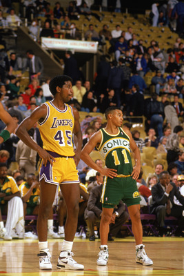 LOS ANGELES - 1990:  Dana Barros #11 of the Seattle Supersonics and A.C. Green #45 of the Los Angeles Lakers stand on the line as they wait for a pair of free-throws during the 1989-1990 NBA season game at the Great Western Forum in Los Angeles, Californi