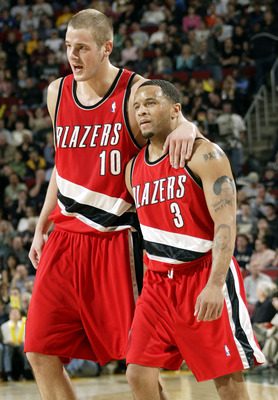 SEATTLE - APRIL 1:  Joel Przybilla #10 of the Portland Trail Blazers walks with his teammate Damon Stoudamire #3 during the game against the Seattle Sonics at Key Arena on April 1, 2005 in Seattle, Washington.  The Sonics won 89-87.  NOTE TO USER: User ex