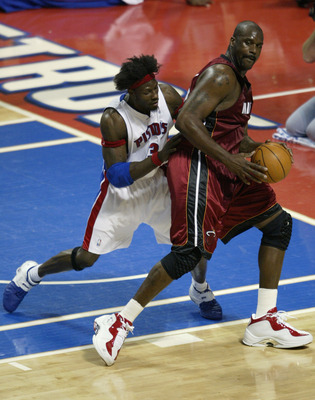 AUBURN HILLS, MI - MAY 29:  Shaquille O'Neal #32 of the Miami Heat posts up against Ben Wallace #3 of the Detroit Pistons in Game Three of the Eastern Conference Finals during the 2005 NBA Playoffs May 29, 2005 at the Palace At Auburn Hills in Auburn Hill