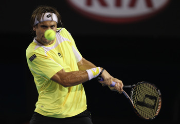 MELBOURNE, AUSTRALIA - JANUARY 26:  David Ferrer of Spain plays a backhand in his quarterfinal match against Rafael Nadal of Spain during day ten of the 2011 Australian Open at Melbourne Park on January 26, 2011 in Melbourne, Australia.  (Photo by Clive B