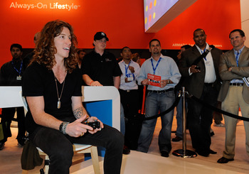 LAS VEGAS - MARCH 24:  Olympic gold medalist snowboarder Shaun White plays the 'Shaun White Snowboarding' video game on an Xbox at the Marvell booth at the International CTIA Wireless 2010 convention at the Las Vegas Convention Center March 24, 2010 in La
