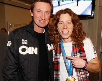 VANCOUVER, BC - FEBRUARY 18:  Shaun White of the United States poses with his men's halfpipe Olympic gold medal and hockey great Wayne Gretzky at the USA House on February 18, 2010 in Vancouver, Canada.  (Photo by Christopher Polk/Getty Images)