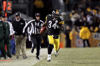 PITTSBURGH, PA - JANUARY 23:  Running back Rashard Mendenhall #34 of the Pittsburgh Steelers runs with the ball against the New York Jets during the 2011 AFC Championship game at Heinz Field on January 23, 2011 in Pittsburgh, Pennsylvania. The Steelers wo