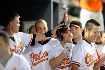 BALTIMORE - AUGUST 31:  Luke Scott #30 of the Baltimore Orioles celebrates with teammate Matt Wieters #32 after hitting a home run in the eighth inning against the Boston Red Sox at Camden Yards on August 31, 2010 in Baltimore, Maryland.  (Photo by Greg F
