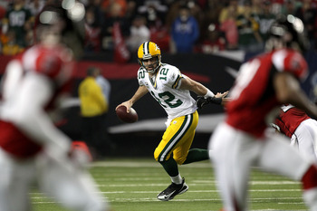 ATLANTA, GA - JANUARY 15:  Aaron Rodgers #12 of the Green Bay Packers rolls out of the pocket to pass against the Atlanta Falcons during their 2011 NFC divisional playoff game at Georgia Dome on January 15, 2011 in Atlanta, Georgia.  (Photo by Streeter Le