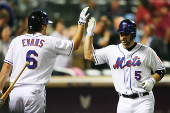 NEW YORK - SEPTEMBER 28: Nick Evans #6 high-fives David Wright #5 of the New York Mets after Wright's two run home run in the sixth inning against the Milwaukee Brewers on September 28, 2010 at Citi Field in the Flushing neighborhood of the Queens borough