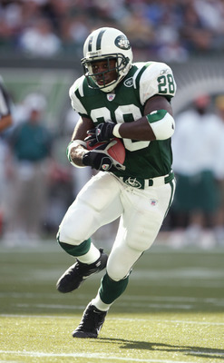 NEW YORK - SEPTEMBER 18:  Curtis Martin #28 of the New York Jets carries the ball during the game with the Miami Dolphins on September 18, 2005 at Giants Stadium in East Rutherford, New Jersey. The Jets defeated the Dolphins 17-7. (Photo by Al Bello/Getty