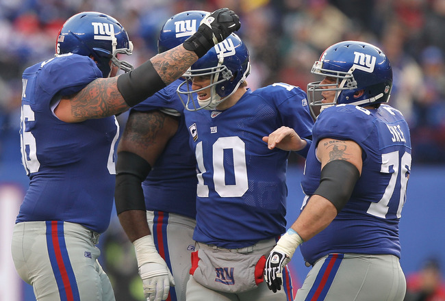 EAST RUTHERFORD, NJ - DECEMBER 19: Eli Manning #10 of the New York Giants celebrates a touchdown by Mario Manningham against  the Philadelphia Eagles during their game on December 19, 2010 at The New Meadowlands Stadium in East Rutherford, New Jersey.  (P