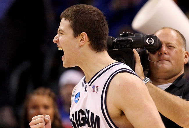 OKLAHOMA CITY - MARCH 18:  Jimmer Fredette #32 of the BYU Cougars celebrates after BYU won in 99-92 double in overtime against the Florida Gators during the first round of the 2010 NCAA men�s basketball tournament at Ford Center on March 18, 2010 in Oklah