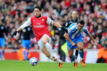 LONDON, ENGLAND - JANUARY 30:  Samir Nasri of Arsenal goes past Gary Roberts of Huddersfield during the FA Cup sponsored by E.ON fourth round match between Arsenal and Huddersfield Town at The Emirates Stadium on January 30, 2011 in London, England.  (Pho