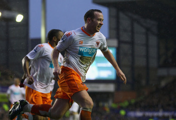 LIVERPOOL, ENGLAND - FEBRUARY 05:  Charlie Adam of Blackpool celebrates after scoring his teams third goal during the Barclays Premier League match between Everton and Blackpool at Goodison Park on February 5, 2011 in Liverpool, England.  (Photo by Clive