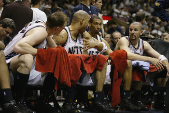 EAST RUTHERFORD, NJ - JUNE 9:  (L-R)Keith Van Horn #44, Kenyon Martin #6, Kerry Kittles #30 and Jason Kidd #5 of the New Jersey Nets talk on the bench in Game three of the 2002 NBA Finals against the Los Angeles Lakers at Continental Airlines Arena in Eas