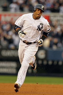 NEW YORK - OCTOBER 20:  Robinson Cano #24 of the New York Yankees rounds the bases after hitting a solo homerun in the third inning against the Texas Rangers in Game Five of the ALCS during the 2010 MLB Playoffs at Yankee Stadium on October 20, 2010 in th