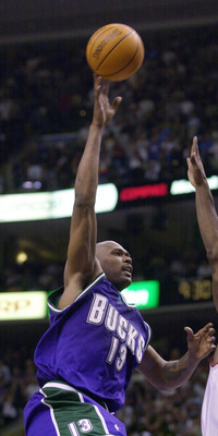 3 Jun 2001: Glenn Robinson #13 of the Milwaukee Bucksputs a shot up in game seven of the eastern conference finals against the Philadephia 76ers at the First Union Center in Philadephia, Pennsylvania.  The 76ers won 85-71 to take the series 4-3.  DIGITAL