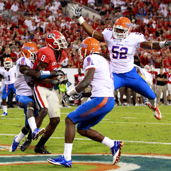 JACKSONVILLE, FL - OCTOBER 30:  A.J. Green #8 of the Georgia Bulldogs catches a pass for a touchdown against Jonathan Bostic #52 of the Florida Gators during the game at EverBank Field on October 30, 2010 in Jacksonville, Florida.  (Photo by Sam Greenwood