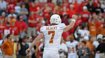 LINCOLN, NE - OCTOBER 16: Quarterback Garrett Gilbert #7 of the Texas Longhorns runs toward his teammates ofter the final of their game against the Nebraska Cornhuskers at Memorial Stadium on October 16, 2010 in Lincoln, Nebraska. Texas Defeated Nebraska