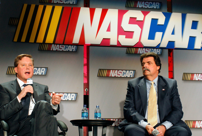 CHARLOTTE, NC - JANUARY 26:  NASCAR CEO and Chairman Brian France (L) and President Mike Helton, speak with the media during the NASCAR Sprint Media Tour hosted by Charlotte Motor Speedway, held at the NASCAR Hall of Fame on January 26, 2011 in Charlotte,