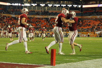 MIAMI, FL - JANUARY 03: Coby Fleener #82 (C) and Owen Marecic #48 (R) of the Stanford Cardinal celebrate after Fleener scored his 3rd touchdown of the game against the Virginia Tech Hokies during the 2011 Discover Orange Bowl at Sun Life Stadium on Januar