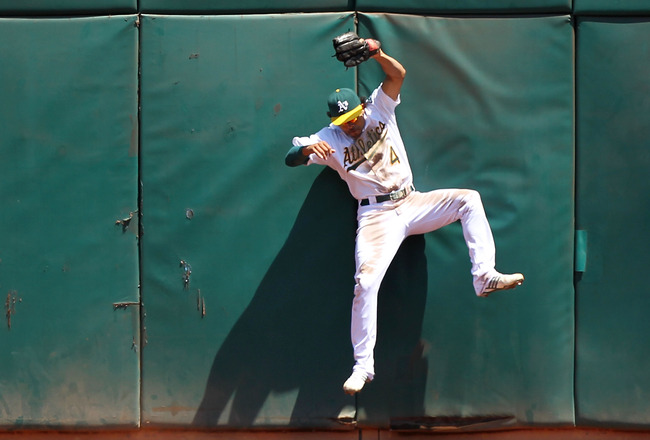 OAKLAND, CA - AUGUST 08:  Coco Crisp #4 of the Oakland Athletics catches a ball hit by Bengie Molina of the Texas Rangers during an MLB game at the Oakland-Alameda County Coliseum on August 8, 2010 in Oakland, California.  (Photo by Jed Jacobsohn/Getty Im