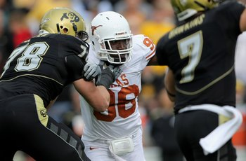 Solder (in black) blocks Texas Longhorn Brian Orakpo.