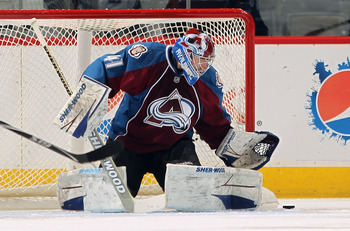 DENVER, CO - JANUARY 18:  Goalie Craig Anderson #41 of the Colorado Avalanche makes a save against the Vancouver Canucks at the Pepsi Center on January 18, 2011 in Denver, Colorado. The Avalanche defeated the Canucks 4-3 in overtime.  (Photo by Doug Pensi