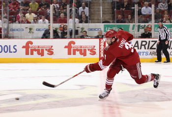 GLENDALE, AZ - JANUARY 22:  Keith Yandle #3 of the Phoenix Coyotes shoots the puck during the NHL game at Jobing.com Arena on January 22, 2011 in Glendale, Arizona.  The Kings defeated the Coyotes 4-3.  (Photo by Christian Petersen/Getty Images)