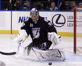 TAMPA, FL - JANUARY 25: Dwayne Roloson #35 of the Tampa Bay Lightning makes a save against the Toronto Maple Leafs at St. Pete Times Forum on January 25, 2011 in Tampa, Florida. The Lightning defeated the Leafs 2-0. (Photo by Justin K. Aller/Getty Images)