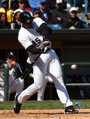 CHICAGO - MAY 2:  Designated hitter Frank Thomas #35 of the Chicago White Sox hits a solo home run in the fourth inning against the Toronto Blue Jays on May 2, 2004 at U.S. Cellular Field in Chicago, Illinois. The White Sox defeated the Blue Jays 3-2.  (P