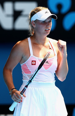 MELBOURNE, AUSTRALIA - JANUARY 27:  Caroline Wozniacki of Denmark celebrates winning a point in her semifinal match against Na Li of China during day eleven of the 2011 Australian Open at Melbourne Park on January 27, 2011 in Melbourne, Australia.  (Photo