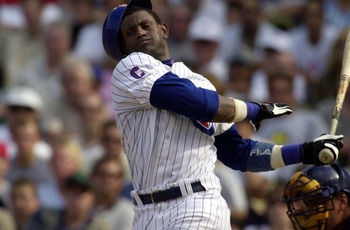23 Aug 2001:  Outfielder Sammy Sosa #21 of the Chicago Cubs swings at a pitch so hard that he loses his batting helmet in the seventh inning of a game against the Milwaukee Brewers at Wrigley Field in Chicago, Illinois. The Brewers won 8-1. DIGITAL IMAGE