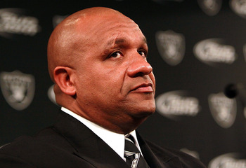 ALAMEDA, CA - JANUARY 18:  Hue Jackson looks on after he was introduced as the new head coach of the Oakland Raiders on January 18, 2011 in Alameda, California.  Hue Jackson was introduced as the new coach of the Oakland Raiders, replacing the fired Tom C