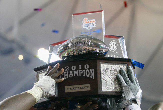 ATLANTA, GA - DECEMBER 31:  The Florida State Seminoles hold up the trophy after their 26-17 win over the South Carolina Gamecocks during the 2010 Chick-fil-A Bowl at Georgia Dome on December 31, 2010 in Atlanta, Georgia.  (Photo by Kevin C. Cox/Getty Ima